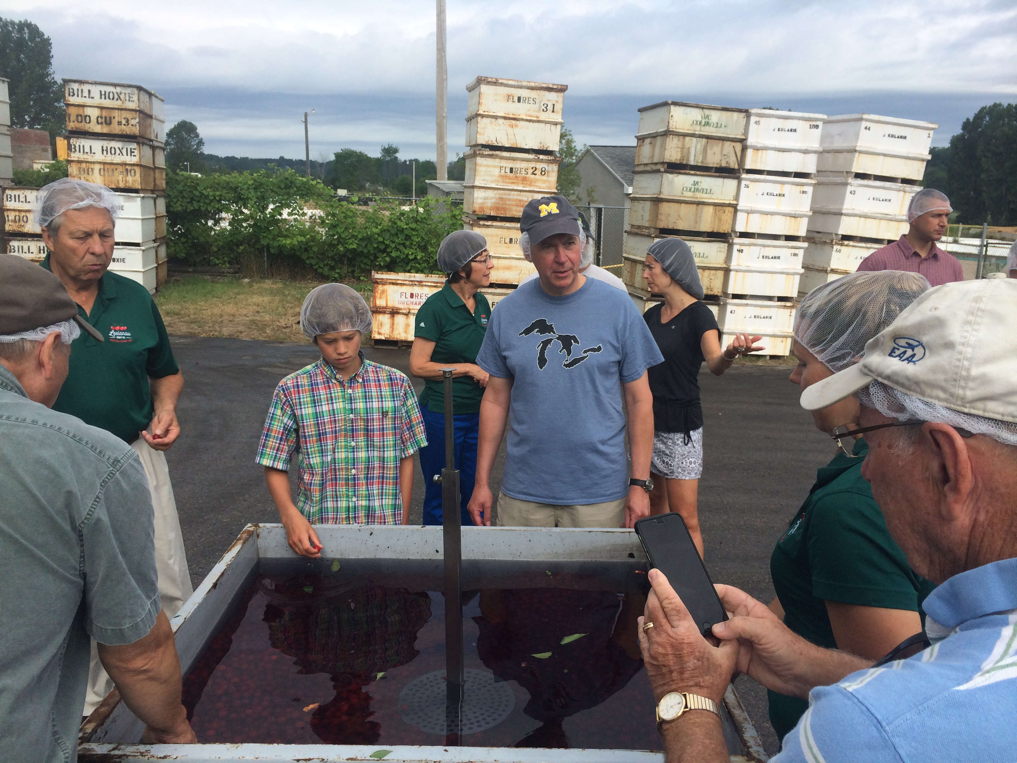 Governor Snyder inspects a tank of tart cherries fresh from the orchard.